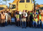 """Drivers for Charleston, South Carolina-based Bulldog Hiway Express proudly show off the American Trucking Associations' 2016 safety award. Bulldog drivers were recognized for driving more than 11 million miles without a chargeable accident. Those 11 million accident-free miles, along with envious CSA safety scores, contributed to Bulldog taking home first place honors in the """"general commodity/local haul"""" category (up to 25 million miles), and in the """"heavy haul – unlimited"""" category of the 2016 American Trucking Associations safety awards. The company came in second in the """"flatbed/line-haul"""" segment (up to 10 million miles). (Photo: Business Wire)"""