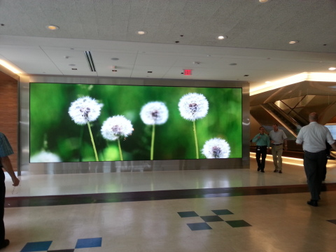Cigna has installed a floor to ceiling 28-foot LED screen that projects imagery designed to evoke cognitive breaks, micro restorative experiences, and reduced stress levels. (Photo: Business Wire)