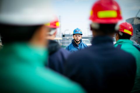 Supervisor Alfredo Dajer, graduate of the Philly Shipyard Apprentice Program, speaks to a group of s ...