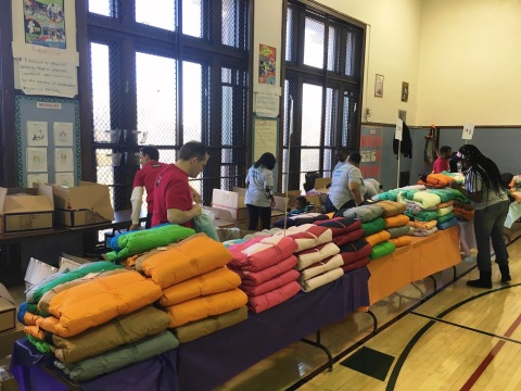 Wells Fargo and Operation Warm, Inc. volunteers organize free winter coats for low-income Chicago st ...