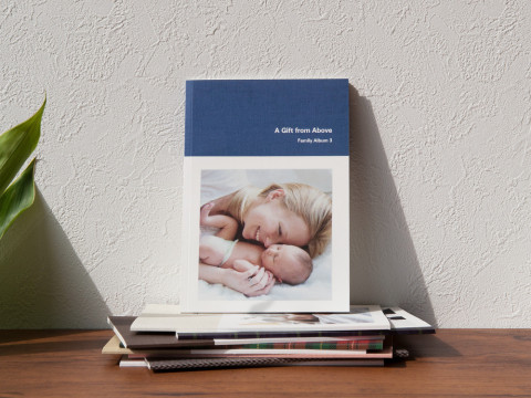 Larger than a smartphone display and lighter than a large photobook, these photobooks are convenient and optimally sized. (Photo: Business Wire)