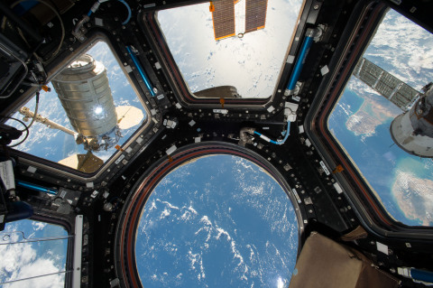 Orbital ATK's Cygnus cargo spacecraft is seen from the Cupola module windows aboard the Internationa ...