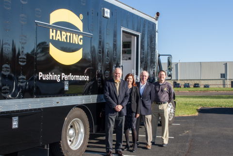 Highlighting the partnership between PEI-Genesis and HARTING is (from left) PEI-Genesis Chairman & CEO Steven Fisher; Christelle Smith, HARTING Distribution Account Manager; Greg Warshaw, PEI-Genesis's CFO; and Keith Christie, HARTING Territory Sales Manager. The HARTING Roadshow Truck is outfitted to educate distribution partners and manufacturer representatives on connectivity technologies and trends so they can find the best solutions for customers. (Photo: Business Wire)