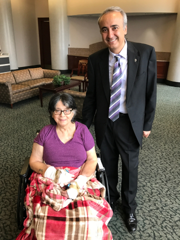 Louella Aker, double hand transplant patient, with Dr. Tuna Ozyurekoglu, lead surgeon, Kleinert Kutz Hand Care Center (Photo: Business Wire)