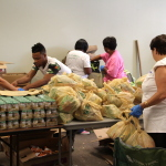 Volunteers at Nourishment Network/The Food Bank of North Florida (LSS), Jacksonville, Fla., sort through non-perishable goods donated by employees of The Main Street America Group. (Photo: Business Wire)