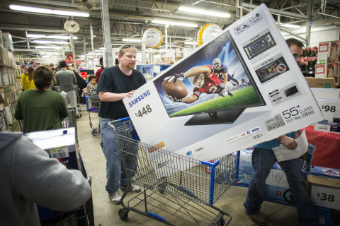 Patrick Bowhey leaves Walmart with a new 55 inch television after shopping Walmart's Black Friday event. (Photo: Business Wire)