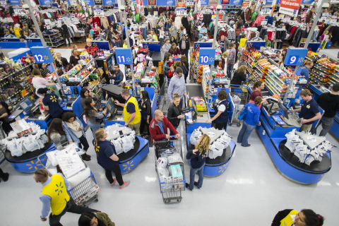 Walmart customers check out after shopping the store's Black Friday event. (Photo: Business Wire)