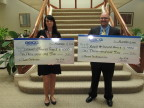 GEICO presents its 24th Annual Volunteer Service Awards recipients Naomi Chatterton and Russell Santamarina with $1,000 checks to benefit a charity of their choice. (Photo: Business Wire)
