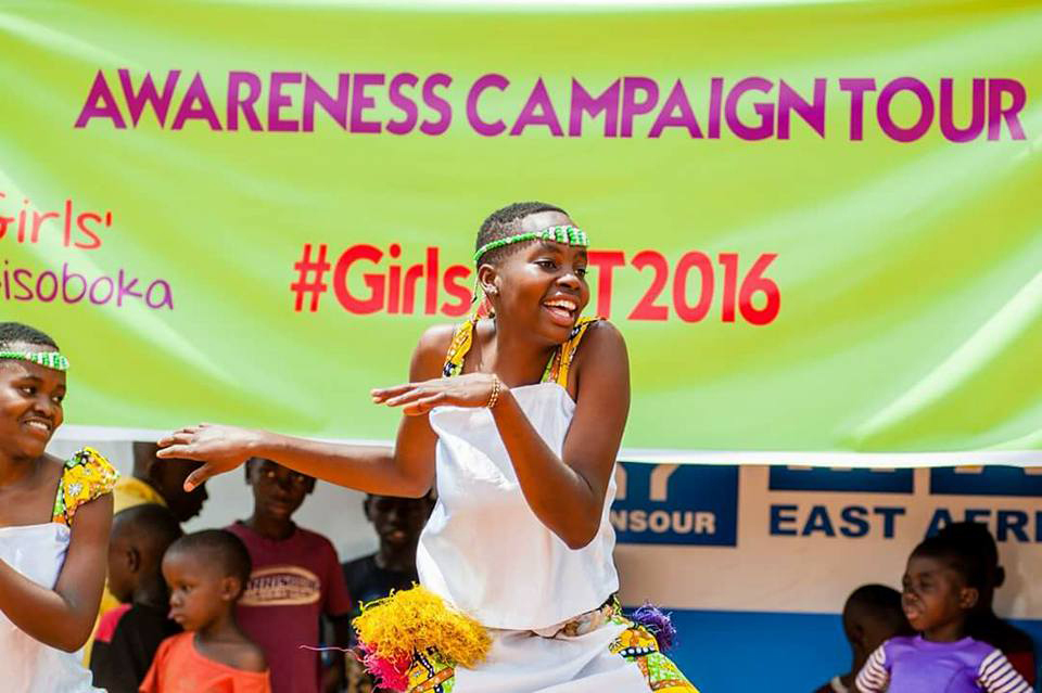 A young girl dances at the launch of Girls ACT in Kampala Uganda. (Photo: Business Wire)