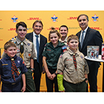 DHL Express Global CEO Ken Allen, Baltimore Area Council COO Manny Fonseca and DHL Express Americas CEO Mike Parra, (left to right), recognized four Boy Scouts, each representing one of the four levels of the Boy Scout program, for their efforts in helping to raise funds to provide 24 pallets of popcorn being shipped by DHL Express to U.S. troops in Afghanistan, Kuwait and Djibouti. (Photo: Business Wire)