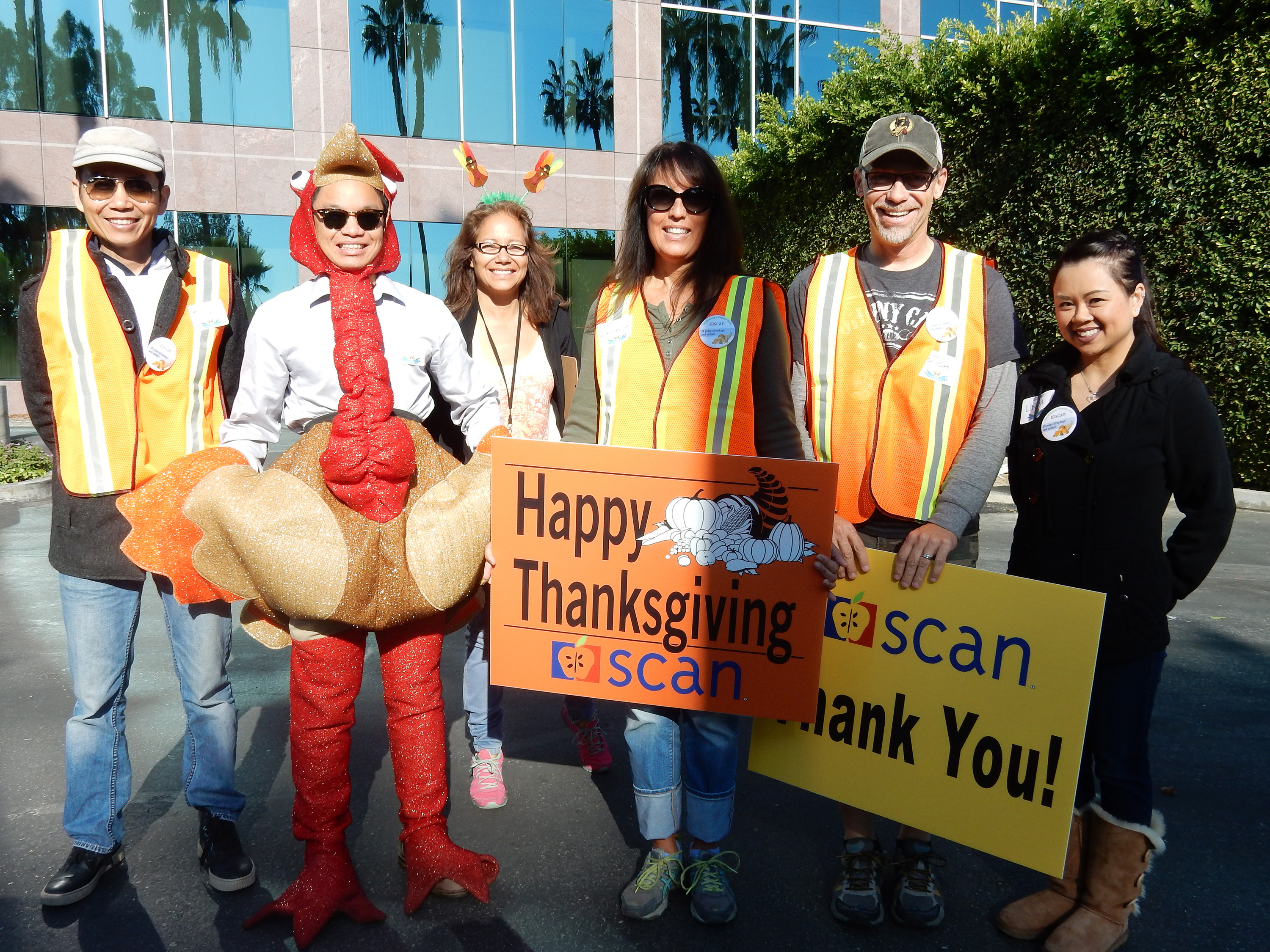 Volunteers help direct traffic at SCAN's 24th annual Thanksgiving meal delivery event in Long Beach. (Photo: Business Wire)