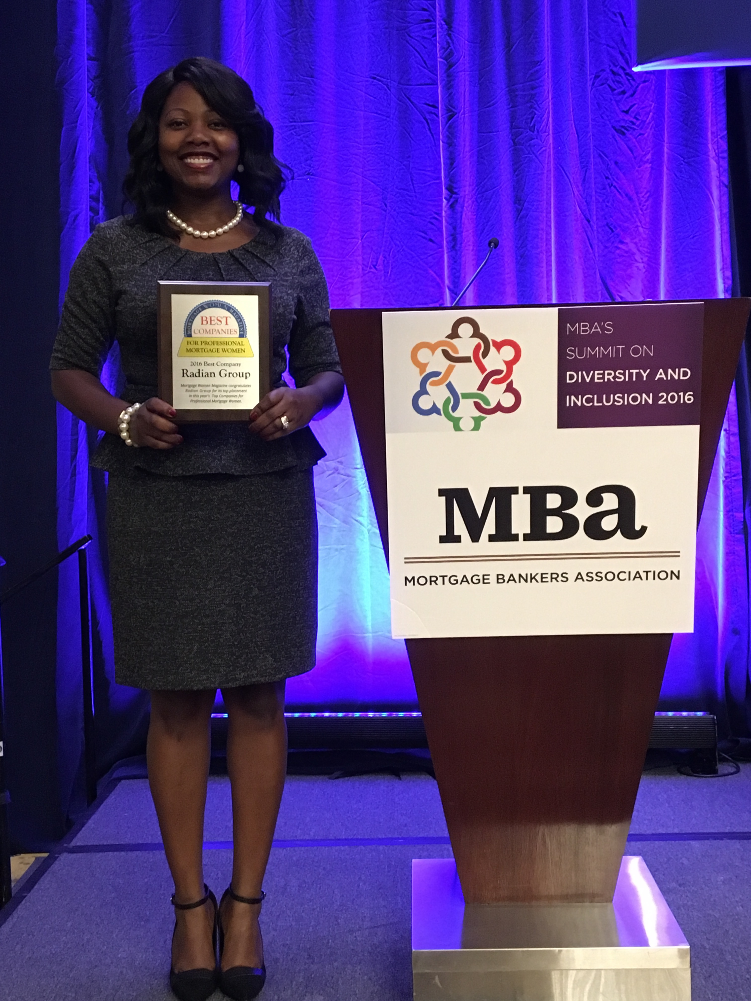 MJ Watkins, Multicultural Business Manager, Asian & African American Segments, receives the Best Company for Professional Women Award on behalf of Radian. (Photo: Business Wire)