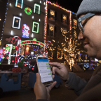 Alexander Du, a resident of Miracle on South 13th Street in Philadelphia, controls his holiday lights at the tap of an app thanks to Samsung SmartThings smart home devices. (Photo: Business Wire)