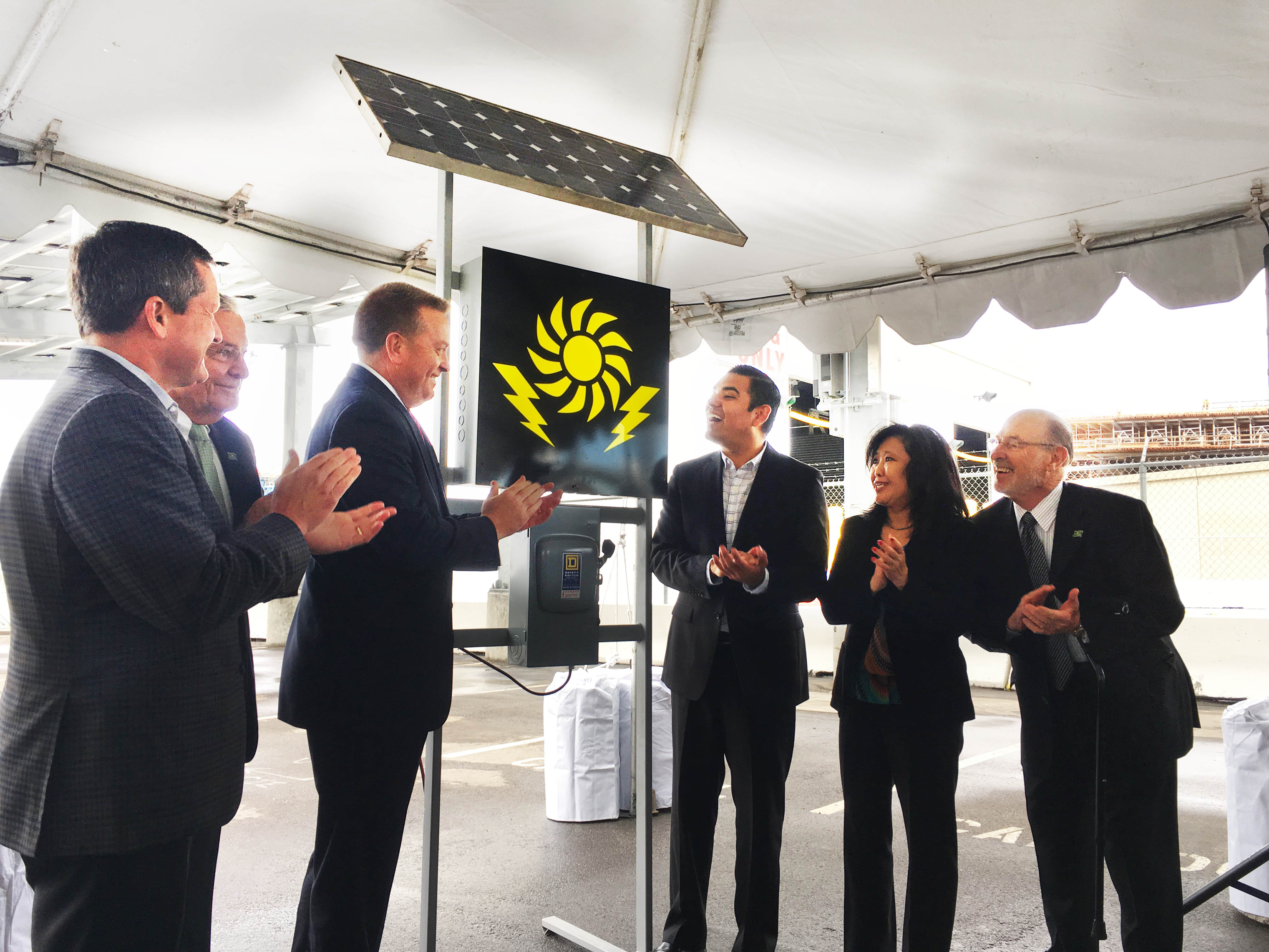 L to R: Allan Schurr, president of Edison Energy; Doug Drummond, commissioner of the Port of Long Beach; Anthony Otto, president of Long Beach Container Terminal; Long Beach Mayor Robert Garcia; Gina Heng, vice president and general manager of Mitsubishi Electric Photovoltaic Division; and James Hankla, senior vice president of governmental relations at PFMG Solar, watch the ceremonial flip of the switch to power on the new 904.75kW solar array at Long Beach Container Terminal.