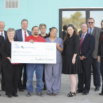 Representatives from FirstBank Southwest and FHLB Dallas joined Rivers Laundromat owner Raul Rios at a check presentation and ribbon-cutting ceremony today in Pampa, Texas. Rivers Laundromat received a $7,500 small business grant from the two banks. (Photo: Business Wire)