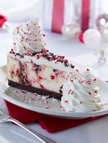 The Cheesecake Factory's Peppermint Bark Cheesecake features a white chocolate cheesecake swirled wi ...