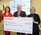 ExxonMobil chairman and chief executive officer Rex W. Tillerson presents the 2016 Chairman's Gift to The Gatehouse in Grapevine, Texas. (Left to right: Lisa Rose, founder and board president, The Gatehouse; Rex Tillerson; Deborah Lyons, executive director, The Gatehouse) (Photo: Business Wire)