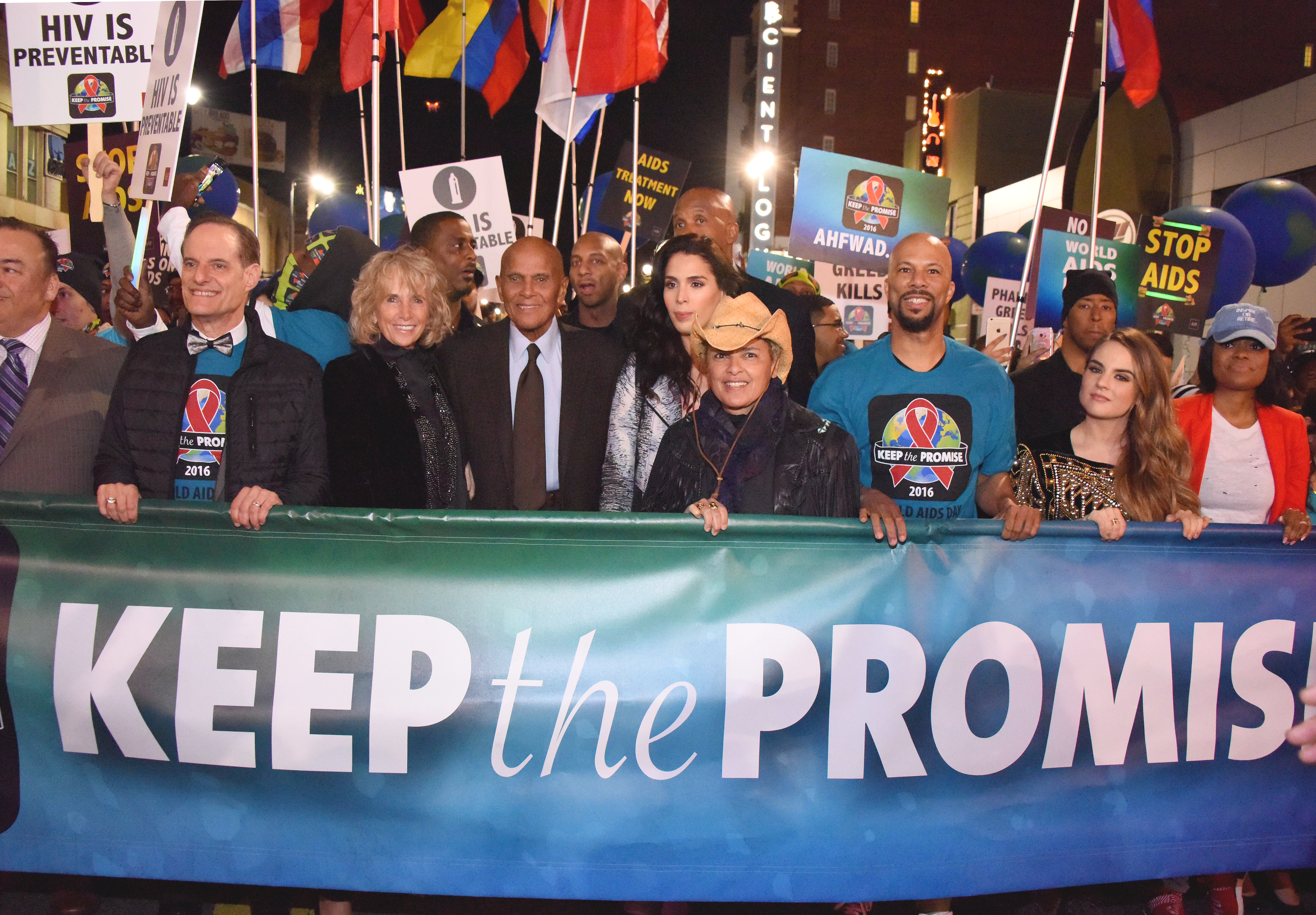 Harry Belafonte (center left, in necktie) and family joined (L to R) marchers Michael Weinstein, AHF President; Pamela Belafonte, Shari Belafonte; recording artists Common and JoJo and Karen Civil for an inspirational moment at  AIDS Healthcare Foundation's 'Keep the Promise' March in Hollywood, CA on November 30, 2016. More than a thousand people marched down historic Hollywood Boulevard on the eve of World AIDS Day to raise awareness about HIV/AIDS and to persuade key decision makers in the U.S. and around the globe to commit more resources and funding to HIV/AIDS prevention, care and treatment. A free Keep the Promise concert at the Dolby Theatre headlined by Patti LaBelle and Common and honoring Belafonte for his lifetime of humanitarian and charitable work followed the march. (Araya Diaz/Getty Images for AIDS Healthcare Foundation)