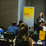 "Karen Damon, senior director of Compliance Import and Regulatory Affairs for DHL Global Forwarding speaks to DHL customers at ""The Evolving World of Customs"" seminar in Atlanta, Georgia. (Photo: Business Wire)"