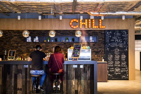 Employees gather in the Chill Lounge (Photo: Business Wire)