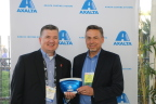 Michael Gogoel (Rt), President of BYK-Gardner USA presents Mike Carr, Axalta President - North America with a commemorative spectrophotometer painted with Axalta's North American Automotive Color of the Year 2016, Brilliant Blue to celebrate the sale of Axalta's 40,000th spectrophotometer. (Photo: Axalta)