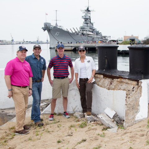 Representatives from Owens Corning and Concrete Preservation Institute on a Battleship Row mooring quay at Pearl Harbor. Owens Corning and its Foundation will support CPI's Career Skills Program at Pearl Harbor to restore the historic mooring quays, while helping U.S. Army personnel transition to civilian jobs. (Photo: Business Wire)