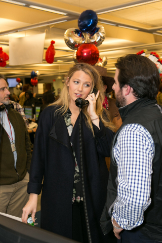 As part of the 24th annual ICAP Charity Day, Blake Lively fields phone calls on the firm's Jersey City trading floor. ICAP Charity Day has raised more than £127 million for over 2,000 charities since 1993.