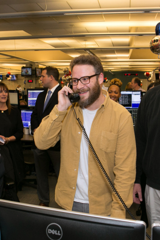 Seth Rogen answers the phones on the trading floor at ICAP's North American headquarters in Jersey City, NJ, during the Group's 24th annual global Charity Day on December 7, 2016. ICAP Charity Day has raised more than £127 million for over 2,000 charities since 1993.