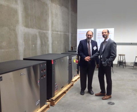 Pictured are Michael Taras, VP of Engineering for ClimateMaster (right), and Dr. Daniel E. Fisher, Head of the Mechanical and Aerospace Engineering Department at the Oklahoma State University in Stillwater, OK, with the donated ClimateMaster units. (Photo: Business Wire)