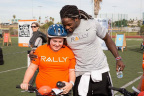"Rally Health and San Diego Chargers running back and Rally Health Ambassador Melvin Gordon hosted a ""Holiday Bike Build"" today for children with parents stationed at Naval Base San Diego. The event gave 52 children the chance to help build Diamondback bikes that they got to take home. Here, Gordon checks out one of the new bikes with a youth. (Photo: Rally Health)"