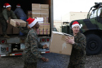 A group of Marines unload a truck full of books, toys and games donated by Barnes & Noble to Toys for Tots in New York City (Photo Credit: Jeff Zelevansky for Barnes & Noble)