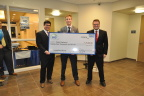 EFG Companies presented Northwood University Team Vigilance members (l-r) Houston Huff of Tucson, AZ, Alec Bond of Lindin, MI, and Lucas Myrhe of Austin, TX with a check for $25,000 as the winner of the 2016 F&I Innovator of the Year competition. (Photo: Business Wire)