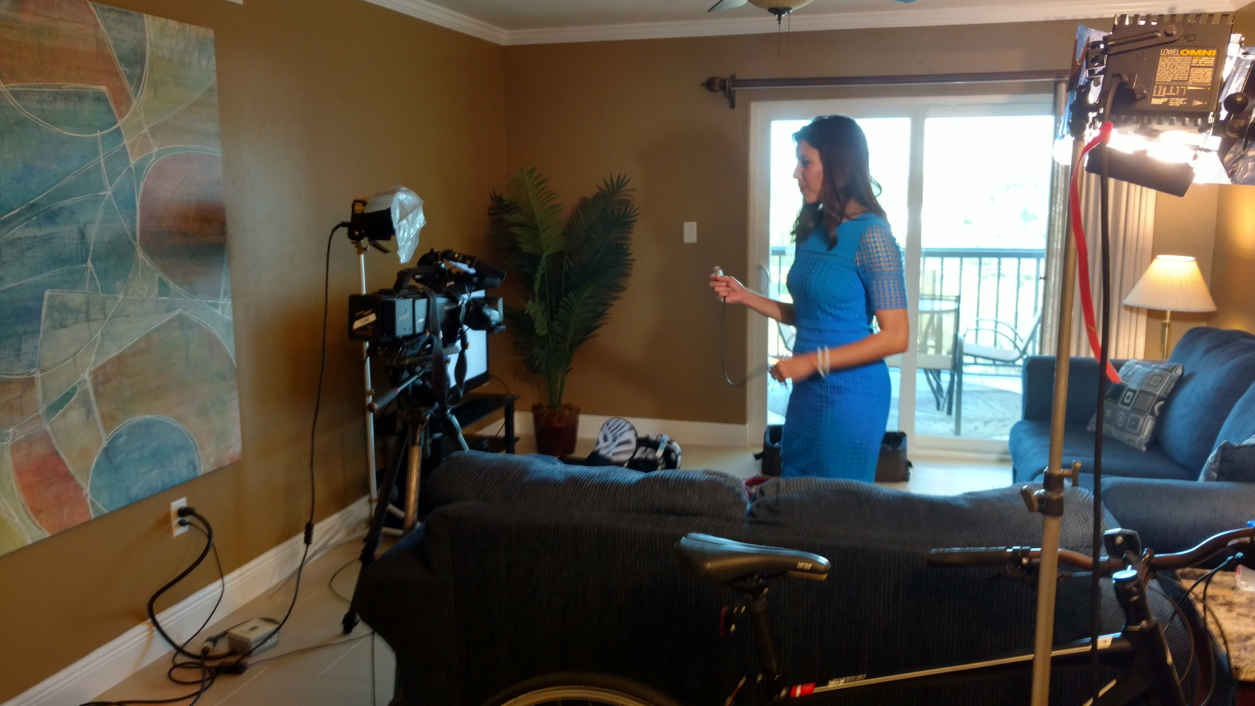 Wink News anchor and reporter Lindsey Sablan preparing for interview in the home of national child guardian and SubscriberWise president David Howe (Photo: Business Wire)