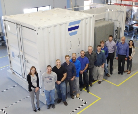 Ambri team in front of lab-based Beta Core system (Photo: Business Wire).