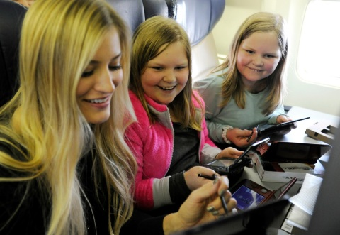 In this photo provided by Nintendo of America, Nintendo surprises passengers on a Southwest Airlines flight from Dallas Love Field to Los Angeles International Airport on Wednesday, Dec. 14. In the air, actress and YouTube celebrity iJustine and Morgan H. and Marley H. of Fort Worth, Texas, play Super Mario Maker for Nintendo 3DS. Passengers received New Nintendo 3DS XL systems and a voucher to download Super Mario Maker for Nintendo 3DS from Nintendo eShop. From Dec. 16, 2016 through Jan. 14, 2017, everyone can get in on the fun and enter the Say Yes to Nintendo 3DS sweepstakes for a chance to win a trip to NYC and Nintendo prize packages. (Photo: Business Wire)