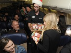 In this photo provided by Nintendo of America, Nintendo surprises passengers on a Southwest Airlines flight from Dallas Love Field to Los Angeles International Airport on Wednesday, Dec. 14. In the air, actress and YouTube celebrity iJustine gifted passengers with a New Nintendo 3DS XL system and a voucher to download Super Mario Maker for Nintendo 3DS from Nintendo eShop. From Dec. 16, 2016 through Jan. 14, 2017, everyone can get in on the fun and enter the Say Yes to Nintendo 3DS sweepstakes for a chance to win a trip to NYC with air travel from Southwest and Nintendo prize packages. (Photo: Business Wire)