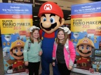 In this photo provided by Nintendo of America, passengers arriving at Los Angeles International Airport are greeted by Mario as they disembark their Southwest Airlines flight from Dallas Love Field on Wednesday, Dec. 14. Pictured, from left to right, are Marley H. of Fort Worth, Texas, and Morgan H. of Fort Worth, Texas. In the air, passengers received New Nintendo 3DS XL systems and a voucher to download Super Mario Maker for Nintendo 3DS from Nintendo eShop. From Dec. 16, 2016 through Jan. 14, 2017, everyone can get in on the fun and enter the Say Yes to Nintendo 3DS sweepstakes for a chance to win a trip to NYC and Nintendo prize packages. (Photo: Business Wire)