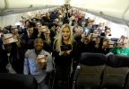 In this photo provided by Nintendo of America, Nintendo surprises passengers on a Southwest Airlines flight from Dallas Love Field to Los Angeles International Airport on Wednesday, Dec. 14. In the air, actress and YouTube celebrity iJustine helped passengers play and create Super Mario levels using Super Mario Maker for Nintendo 3DS. Passengers received a New Nintendo 3DS XL system and a voucher to download Super Mario Maker for Nintendo 3DS from Nintendo eShop. From Dec. 16, 2016 through Jan. 14, 2017, everyone can get in on the fun and enter the Say Yes to Nintendo 3DS sweepstakes for a chance to win a trip to NYC and Nintendo prize packages. (Photo: Business Wire)