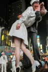 "© 2004, 2005 The Seward Johnson Atelier, Inc. Photo by David W. Steele The 25 foot tall Embracing Peace by sculptor Seward Johnson on view in Times Square, New York City, where the original ""kiss"" took place. (Photo: Axalta)"