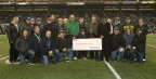 Seahawks High School Coach of the Year – Tumwater High School's Sid Otton – and other High School Coach of the Week recipients are celebrated with UnitedHealthcare and Seahawks officials. UnitedHealthcare representatives pictured (front row, left to right), Britt Wooldridge, vice president of sales; Tim Kussie, vice president of sales; and Jeff Akers, vice president, Regional Growth Office. Also pictured: UnitedHealthcare Pacific Northwest Market CEO Claire Verity (middle row, fifth in from left); and Seattle Seahawks Director of Youth Football and Legends Projects, Paul Johns (front row, fourth in from right). Photo courtesy of Seattle Seahawks.