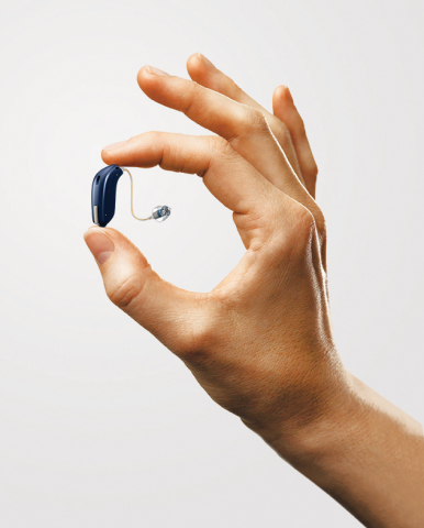 Oticon Opn™, the world's 1st hearing aid that connects to and interacts with the Internet via the IFTTT Network, will be showcased at 2017 CES and 2017 CES Unveiled Las Vegas. Winner of two 2017 CES Innovations Awards for Wearable Technology and Tech for a Better World, the small, discreet hearing aid can be programmed to talk directly with doorbells, smoke detectors & other smart devices via the Oticon ON App. (Photo: Business Wire)