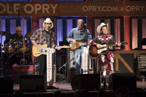 Brad Paisley takes the stage with Little Jimmy Dickens' Madame Tussauds figure at Saturday's Opry at the Ryman event at Ryman Auditorium in Nashville (Photo: Business Wire)
