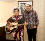 Brad Paisley backstage at the Ryman Auditorium in Nashville with Little Jimmy Dickens' wax figure (Photo: Business Wire)