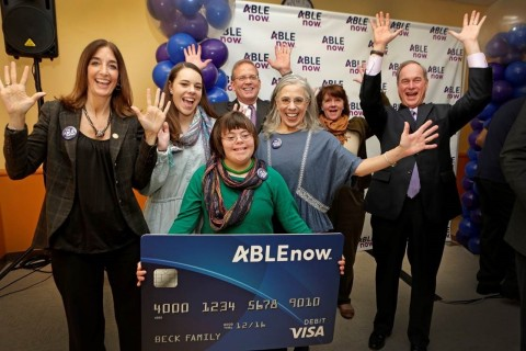 Mary Morris presented the Beck family with the ABLEnow card. Pictured left to right: Delegate Eileen Filler-Corn of the 41st District House of Delegates; Mariae Beck and Natalie Beck (ABLEnow account holder) with mother Catherine Beck; Craig Small, Senior Vice President and Relationship Manager at PNC Financial Services Group; Mary Morris, Virginia529 CEO; and Shawn McLaughlin, Virginia529 Board Chair. (Photo: Business Wire)