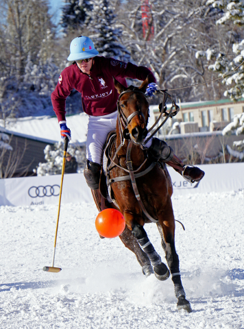 Team Flexjet brings the ball down the field at the Aspen World Snow Polo Championship at Rio Grande Park on Sunday, Dec. 18, 2016, in Aspen, Colorado.