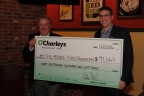 O'Charley's President Eddie Hall presents The Folded Flag Foundation Executive Director John Coogan with a $91,663 donation (Photo: Business Wire)