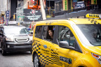 A passenger takes a ride in the new Ford Transit Connect hybrid taxi prototype. Ford will start testing a fleet of 20 Transit Connect hybrid taxi and van prototypes in major cities across the U.S. this year to help businesses reduce their operating costs while still providing plenty of passenger and cargo space. (Photo: Business Wire)