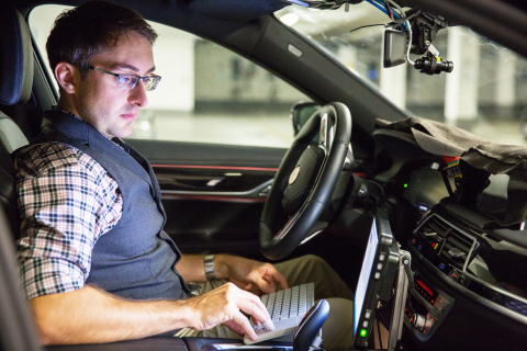 BMW engineer André Mueller tests autonomous driving technology in a BMW autonomous test car. (CREDIT: BMW Group)