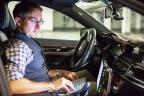 BMW engineer André Mueller tests autonomous driving technology in a BMW autonomous test car. (CREDIT: BMW Group)