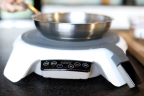 The Paragon Mat precisely controls pan temperature, automatically adjusting burner output, so users will be confident that their food creations will be consistent every time. (Photo: FirstBuild)